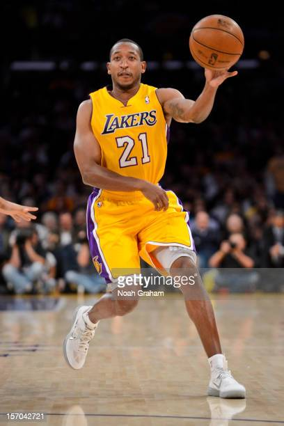 Chris Duhon of the Los Angeles Lakers passes the ball against the Indiana Pacers at Staples Center on November 27 2012 in Los Angeles California NOTE...