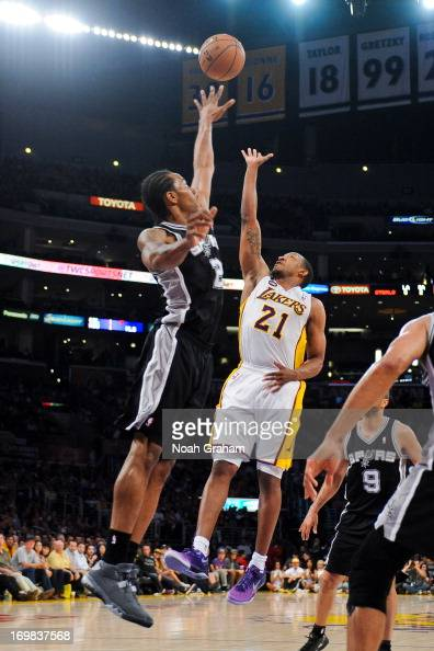 Chris Duhon of the Los Angeles Lakers shoots a floater against Kawhi Leonard of the San Antonio Spurs in Game Four of the Western Conference...