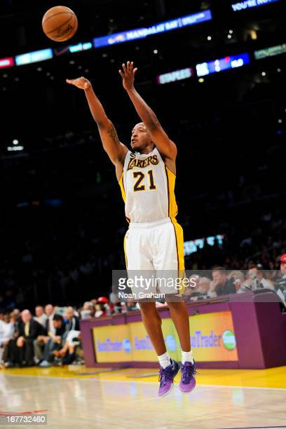 Chris Duhon of the Los Angeles Lakers shoots a threepointer against the San Antonio Spurs in Game Four of the Western Conference Quarterfinals during...