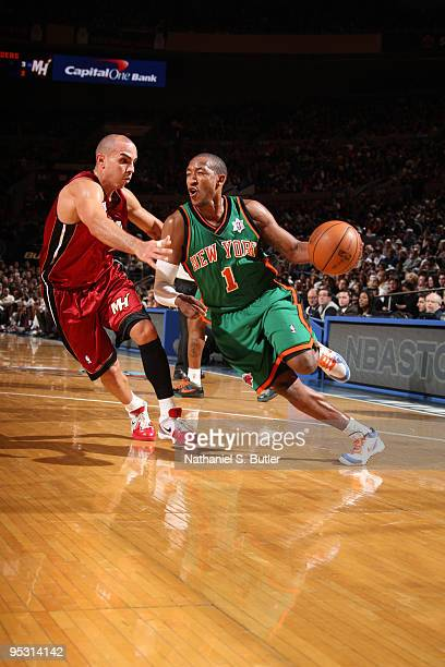 Chris Duhon of the New York Knicks drives against Carlos Arroyo of the Miami Heat on December 25 2009 at Madison Square Garden in New York City NOTE...