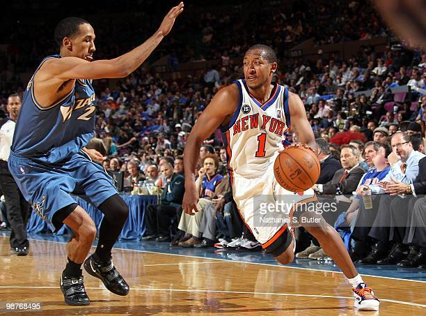 Chris Duhon of the New York Knicks drives the ball against Shaun Livingston of the Washington Wizards during the game at Madison Square Garden on...
