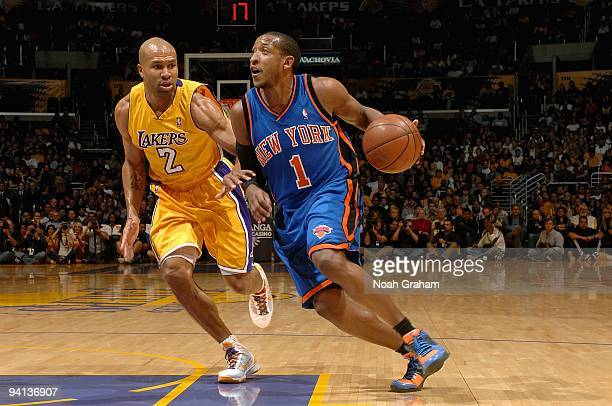 Chris Duhon of the New York Knicks drives to the basket past Derek Fisher of the Los Angeles Lakers during the game on November 24 2009 at Staples...