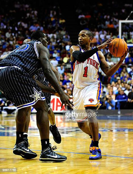 Chris Duhon of the New York Knicks sets up a play during the game against the Orlando Magic at Amway Arena on December 2 2009 in Orlando Florida NOTE...