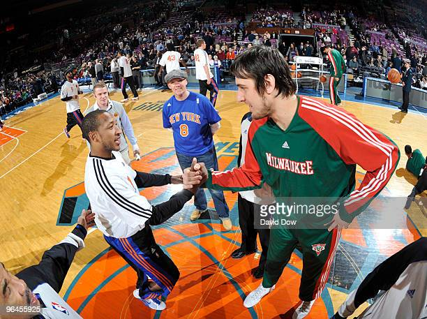 Chris Duhon of the New York Knicks shakes hands with Andrew Bogut of the Milwaukee Bucks on February 5 2010 at Madison Square Garden in New York City...