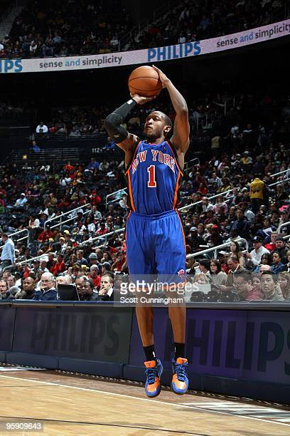 Chris Duhon of the New York Knicks shoots a jump shot during the game against the Atlanta Hawks at Philips Arena on January 01 2010 in Atlanta...