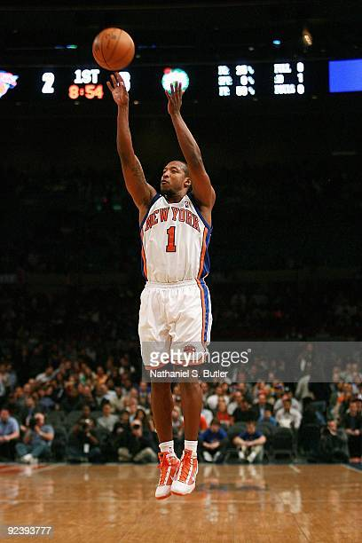 Chris Duhon of the New York Knicks shoots a jumper during the preseason game against the Boston Celtics on October 20 2009 at Madison Square Garden...