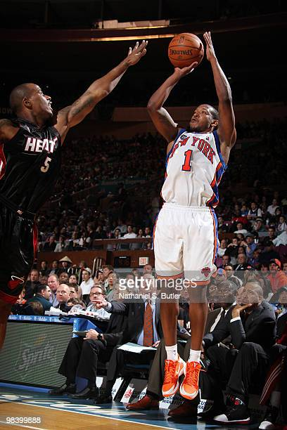 Chris Duhon of the New York Knicks shoots against Quentin Richardson of the Miami Heat on April 11 2010 at Madison Square Garden in New York City...