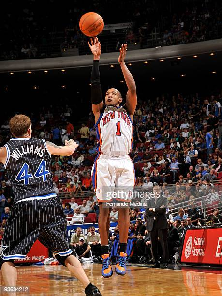 Chris Duhon of the New York Knicks shoots against the Orlando Magic during the game on December 2 2009 at Amway Arena in Orlando Florida NOTE TO USER...