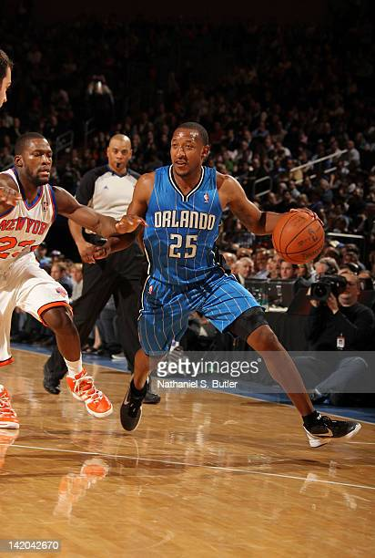 Chris Duhon of the Orlando Magic controls the ball against Toney Douglas of the New York Knicks during the game on March 28 2012 at Madison Square...