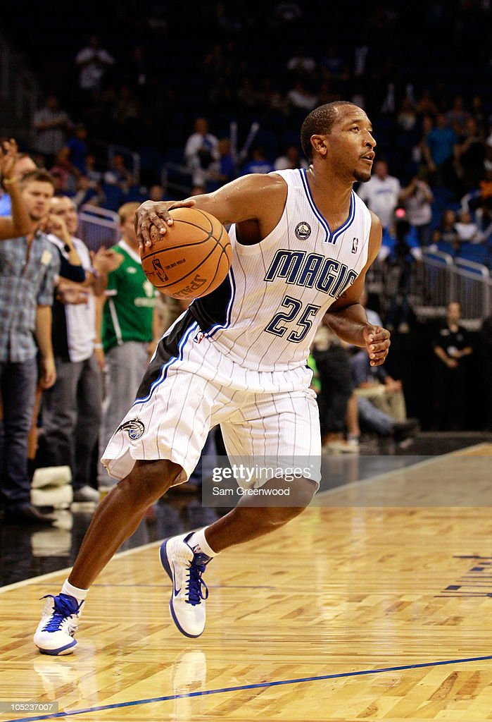 <a gi-track='captionPersonalityLinkClicked' href=/galleries/search?phrase=Chris+Duhon&family=editorial&specificpeople=202879 ng-click='$event.stopPropagation()'>Chris Duhon</a> #25 of the Orlando Magic dribbles during the game against the New Orleans Hornets at Amway Arena on October 10, 2010 in Orlando, Florida.
