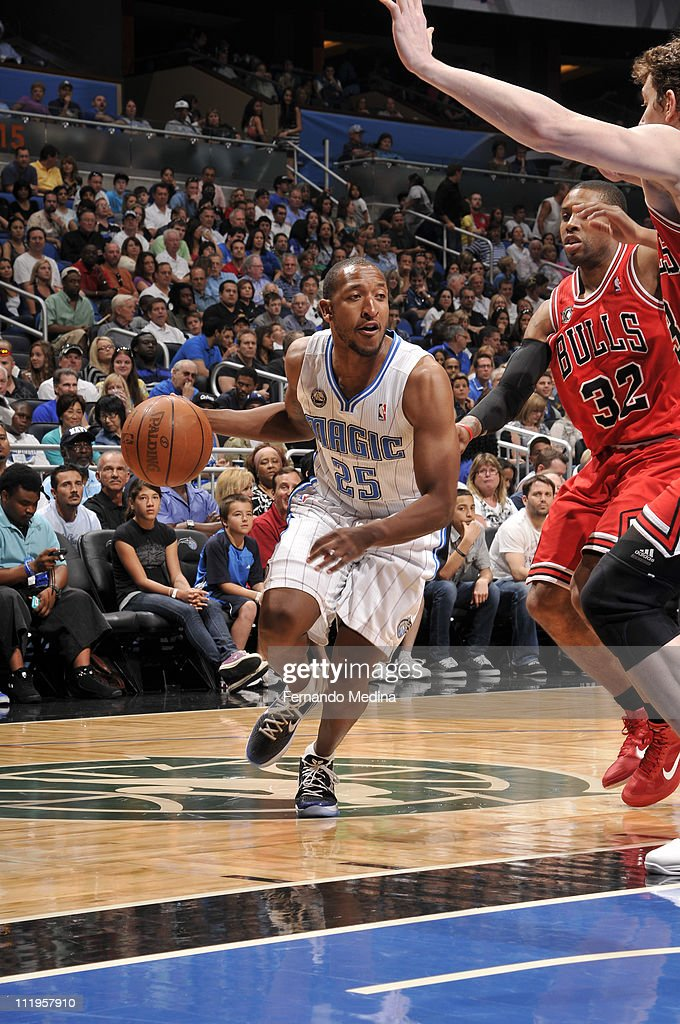 <a gi-track='captionPersonalityLinkClicked' href=/galleries/search?phrase=Chris+Duhon&family=editorial&specificpeople=202879 ng-click='$event.stopPropagation()'>Chris Duhon</a> #25 of the Orlando Magic drives against <a gi-track='captionPersonalityLinkClicked' href=/galleries/search?phrase=C.J.+Watson&family=editorial&specificpeople=740190 ng-click='$event.stopPropagation()'>C.J. Watson</a> #11 and <a gi-track='captionPersonalityLinkClicked' href=/galleries/search?phrase=Omer+Asik&family=editorial&specificpeople=4946055 ng-click='$event.stopPropagation()'>Omer Asik</a> #3 of the Chicago Bulls on April 10, 2011 at the Amway Center in Orlando, Florida.