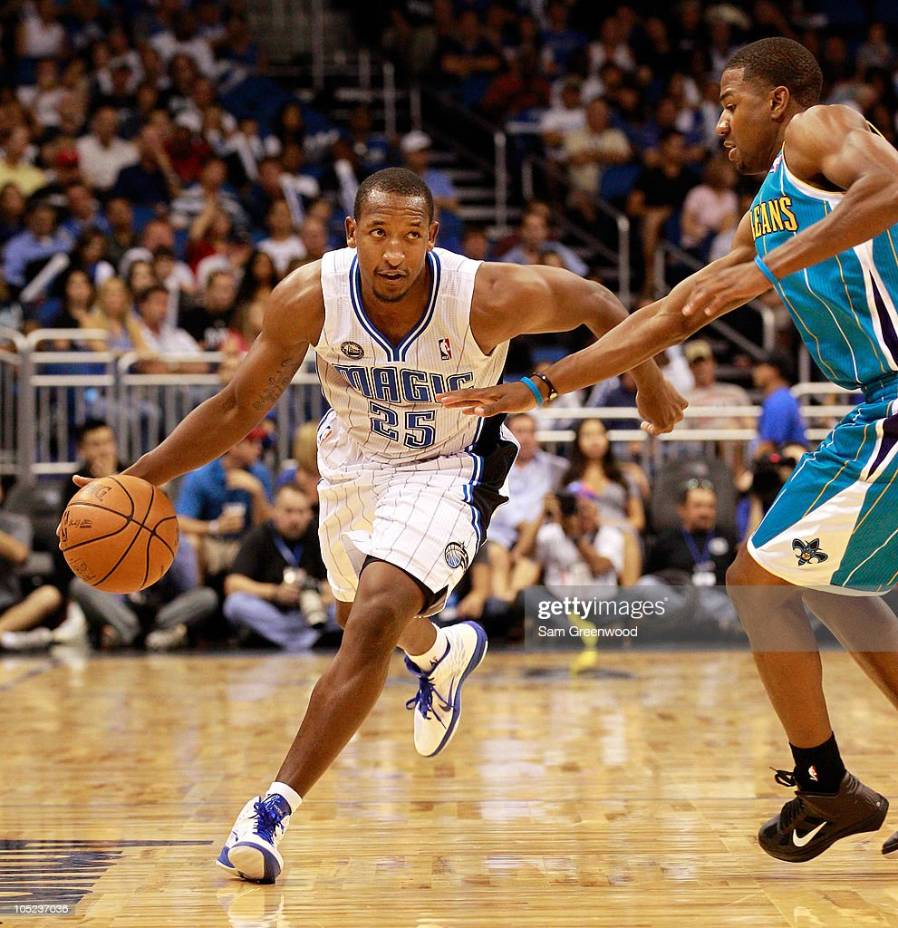<a gi-track='captionPersonalityLinkClicked' href=/galleries/search?phrase=Chris+Duhon&family=editorial&specificpeople=202879 ng-click='$event.stopPropagation()'>Chris Duhon</a> #25 of the Orlando Magic drives against <a gi-track='captionPersonalityLinkClicked' href=/galleries/search?phrase=Marcus+Thornton+-+Basketball+Player+Born+1987&family=editorial&specificpeople=4679329 ng-click='$event.stopPropagation()'>Marcus Thornton</a> #5 of the New Orleans Hornets during the game at Amway Arena on October 10, 2010 in Orlando, Florida.