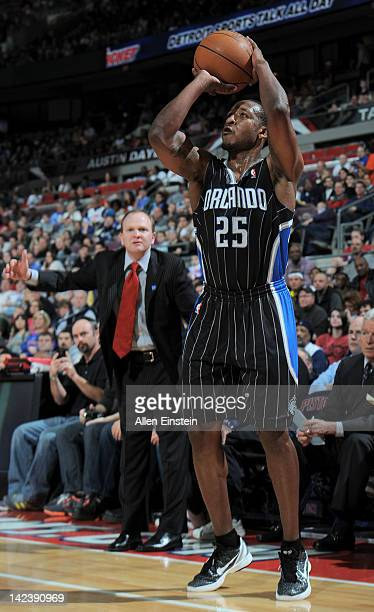 Chris Duhon of the Orlando Magic takes a shot as head coach Lawrence Frank of the Detroit Pistons looks on during the game on April 3 2012 at The...