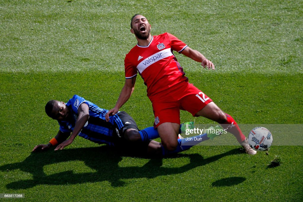 Chris Duvall #18 of Montreal Impact fouls Arturo Alvarez #12 of Chicago Fire and received a yellow card during the second half at Toyota Park on April 1, 2017 in Bridgeview, Illinois. The match ended in a 2-2 draw.