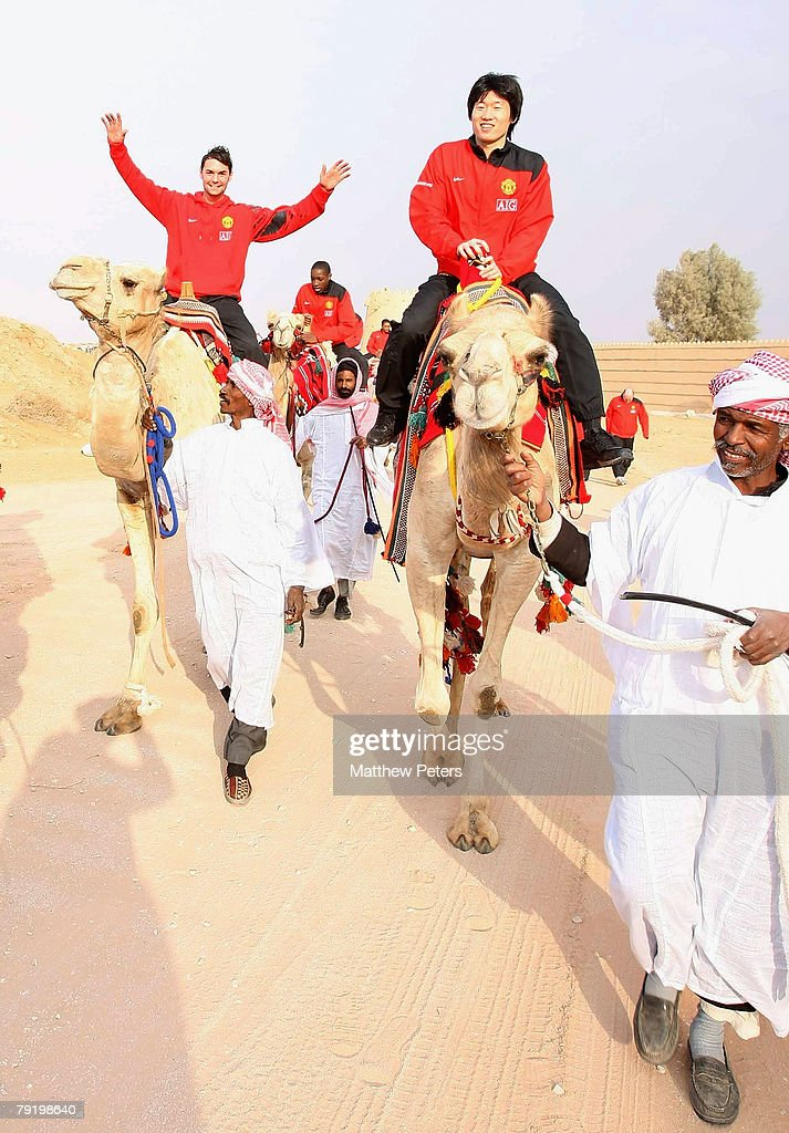 Chris Eagles and Ji-Sung Park of Manchester United rides a camel at the palace of HRH Prince Abdullah bin Mosa'ad bin Abdullaziz on January 23 2008, in Riyadh, Saudi Arabia.