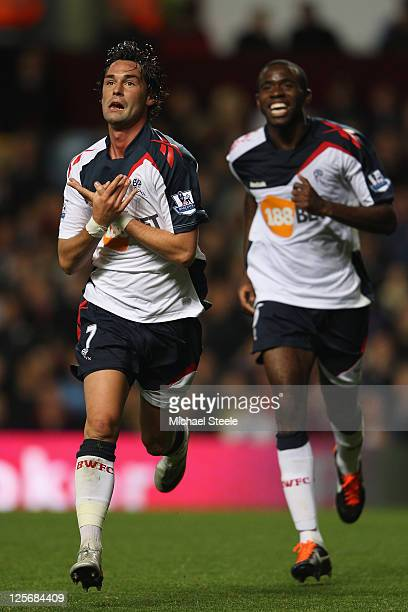 Chris Eagles of Bolton Wanderers celebrates scoring his sides first goal with Fabrice Muamba during the Carling Cup third round match between Aston...