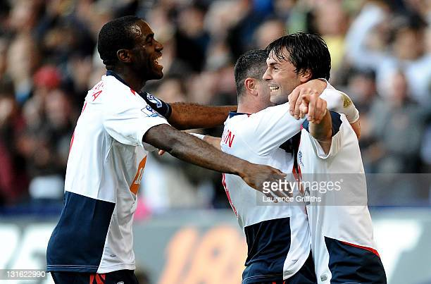 Chris Eagles of Bolton Wanderers celebrates scoring his team's second goal with team mates Fabrice Muamba and Paul Robinson during the Barclays...