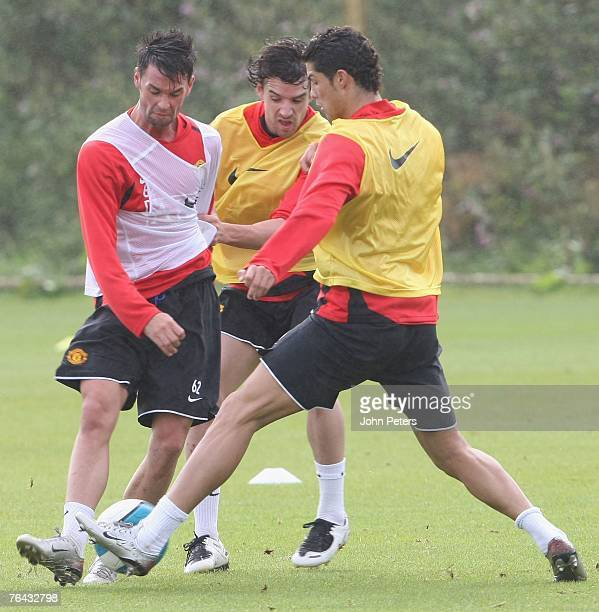 Chris Eagles Owen Hargreaves and Cristiano Ronaldo of Manchester United in action during a First Team Training Session at Carrington Training Ground...