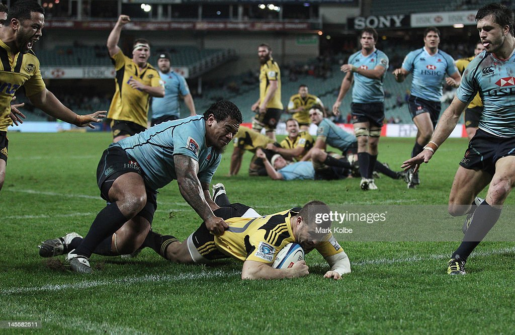 <a gi-track='captionPersonalityLinkClicked' href=/galleries/search?phrase=Chris+Eaton+-+Rugby+Player&family=editorial&specificpeople=15030958 ng-click='$event.stopPropagation()'>Chris Eaton</a> of the Hurricanes scores a try during the round 15 Super Rugby match between the Waratahs and the Hurricanes at Allianz Stadium on June 2, 2012 in Sydney, Australia.