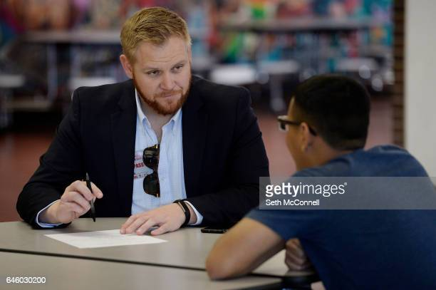 Chris Eaton talks with a student during a mentoring session at Jefferson High School in Edgewater Colorado on February 22 2017 Goodwill Youth...