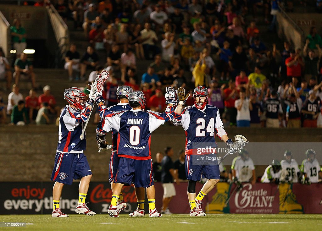 Chris Eck #24 of the Boston Cannons celebrates a goal with teammates against the New York Lizards in the third quarter at Harvard Stadium on June 21, 2013 in Boston, Massachusetts.