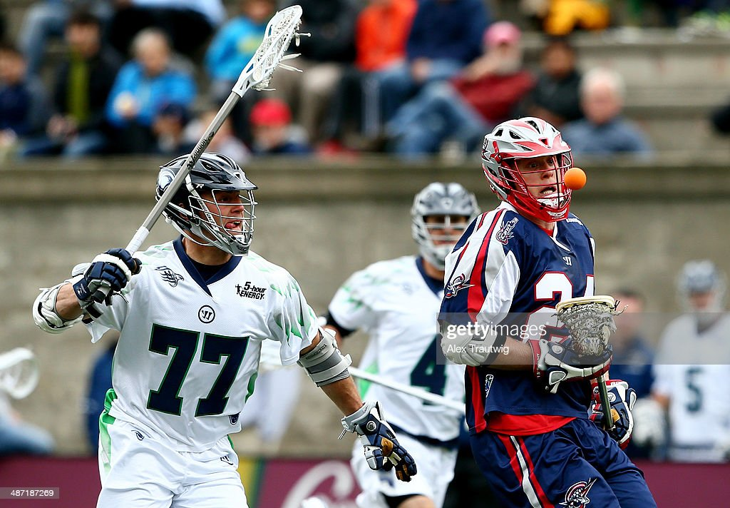 Chris Eck of the Boston Cannons tries to gain control of the ball as Stephen Peyser of the Chesapeake Bayhawks defends during a game at Harvard...