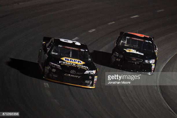 Chris Eggleston driver of the NAPA Filters Toyota and Dillon Bassett driver of the Bassett Gutters and More Toyota race on track during the NASCAR KN...