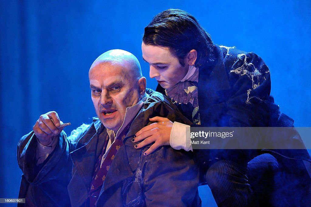 Chris Ellison as Magwich (L) and Taylor Jay-Davies as Young Pip pose during a photcall for 'Great Expectations' at Vaudeville Theatre on February 4, 2013 in London, England.
