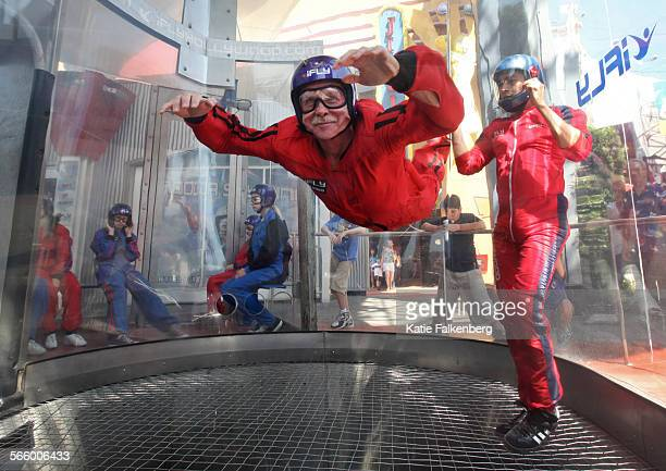 Chris Erskine tries out indoor skydiving at iFly on the Universal City Walk as iFly instructor Marco Gonzalez right assists him iFly creates true...