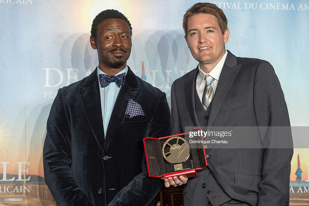 Chris Eska (R) and Tischuan Scott pose with the 'International critics' prize' they won with the film 'The retrieval' on September 7, 2013 in Deauville, France.