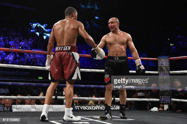 Chris Eubank Jnr and Arthur Abraham show respect for one another after the fight for the IBO World World Super Middleweight title at Wembley Arena on...