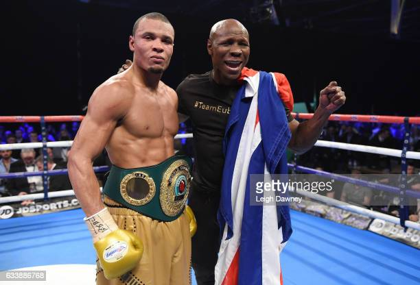 Chris Eubank Jnr celebrates with his father Chris Eubank Snr after defeating Renold Quinlan of Australia to claim the IBO World Super Middleweight...