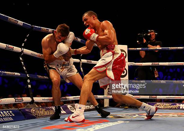 Chris Eubank Jnr of Great Britain and Tom Doran of Great Britain exchange blows during their British Middleweight contest at The O2 Arena on June 25...