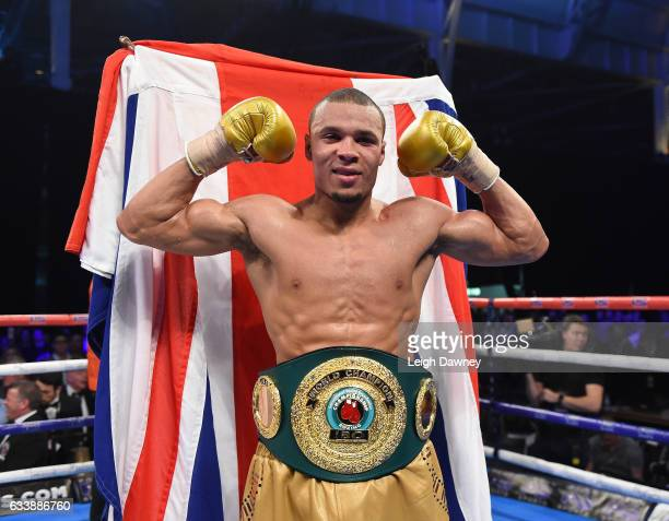 Chris Eubank Jnr of Great Britain celebrates defeating Renold Quinlan of Australia for the IBO World Super Middleweight title Olympia London on...