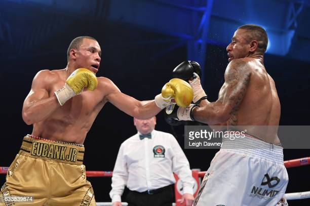 Chris Eubank Jnr of Great Britain in action with Renold Quinlan of Australia during their IBO World Super Middleweight title fight at for the Olympia...