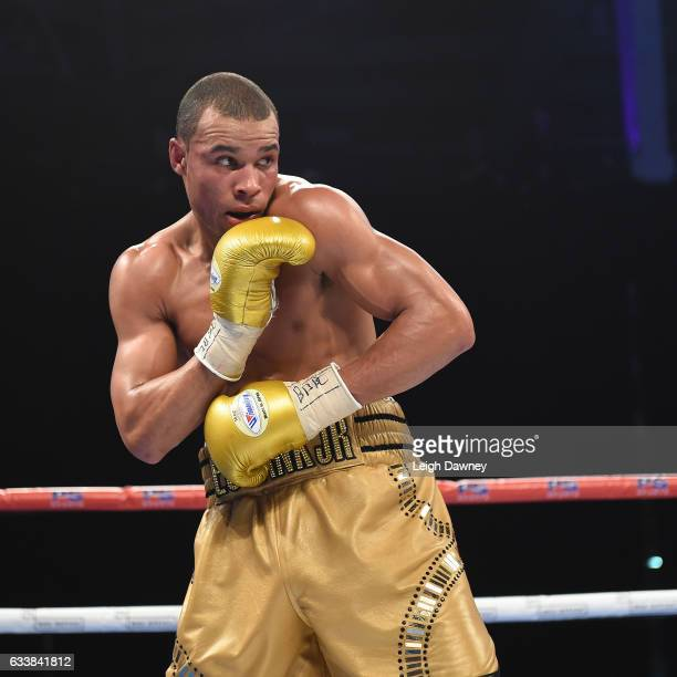Chris Eubank Jnr of Great Britain in action with Renold Quinlan of Australia during their IBO World Super Middleweight title fight at Olympia London...