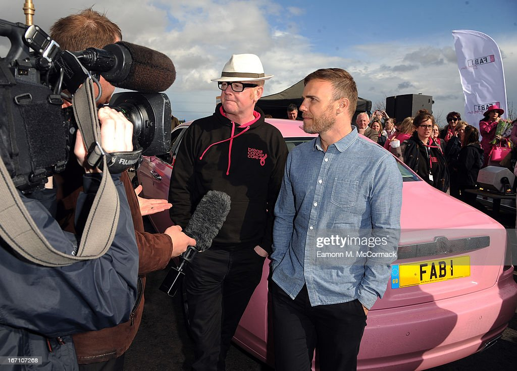 Chris Evans and <a gi-track='captionPersonalityLinkClicked' href=/galleries/search?phrase=Gary+Barlow&family=editorial&specificpeople=616384 ng-click='$event.stopPropagation()'>Gary Barlow</a> take interviews during the FAB1 Million drive from Land's End to John O'Groats on April 18, 2013 in Birmingham, United Kingdom. FAB1 Million aims to raise one million pounds for Breast Cancer Care using a bespoke pink Rolls Royce Ghost with the original FAB1 Thunderbirds number plate, which is available for hire.