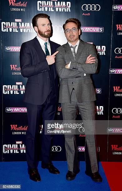 Chris Evans and Robert Downey Jr attend the European Premiere of 'Captain America Civil War' at Vue Westfield on April 26 2016 in London England