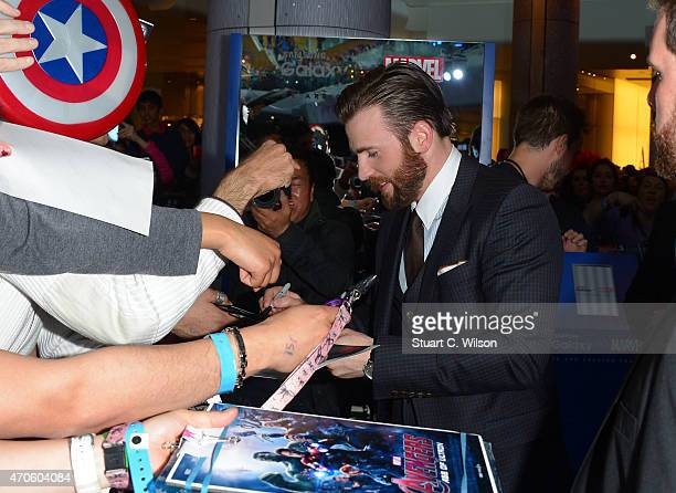 Chris Evans engages with fans after taking a photo with Samsung Galaxy Twitter Mirror at the European Premiere of 'Avengers Age of Ultron' at...