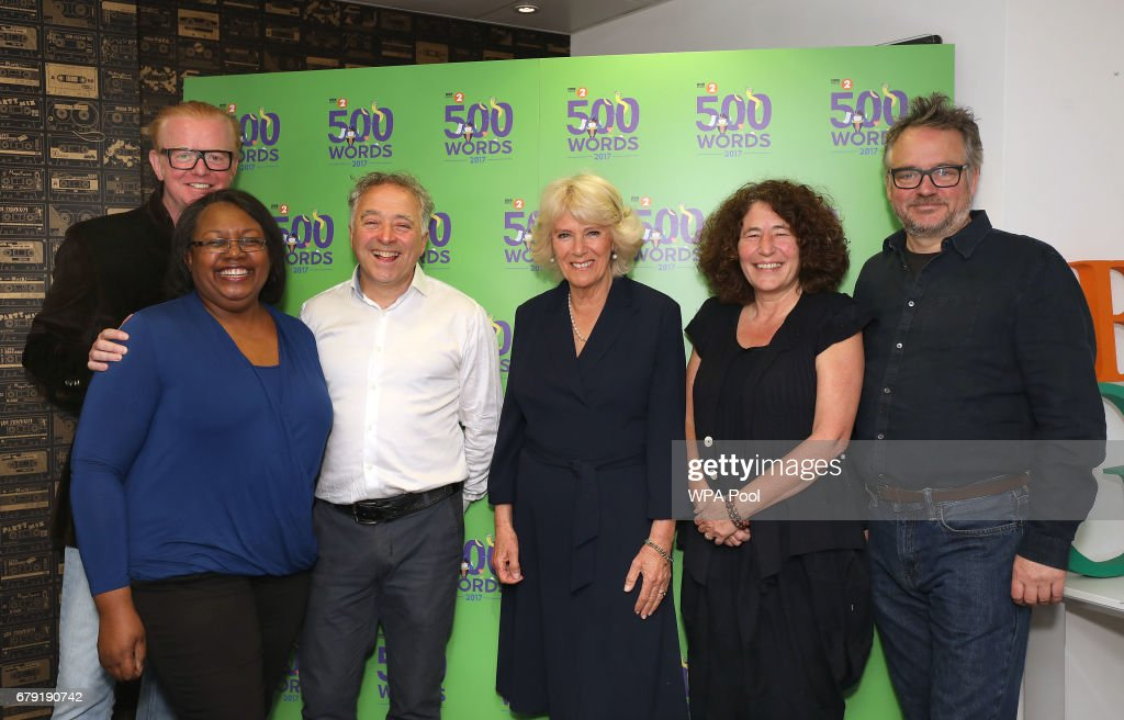 Chris Evans, Malorie Blackman, Frank Cottrell Boyce, Francesca Simon and Charlie Higson pose with Camilla, Duchess (3rd-R) of Cornwall as she joins the '500 Word' judging panel, a creative writing competition, at BBC Radio 2 Studios on May 4, 2017 in London, England.