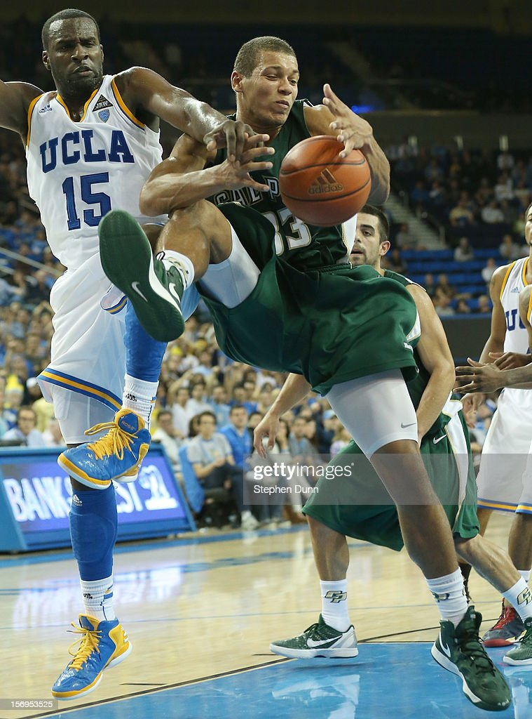 Chris Eversley #33 of the Cal Poly Mustangs fights for a rebound with <a gi-track='captionPersonalityLinkClicked' href=/galleries/search?phrase=Shabazz+Muhammad&family=editorial&specificpeople=7447677 ng-click='$event.stopPropagation()'>Shabazz Muhammad</a> #15 of the UCLA Bruins at Pauley Pavilion on November 25, 2012 in Los Angeles, California. Cal Poly won 70-68.