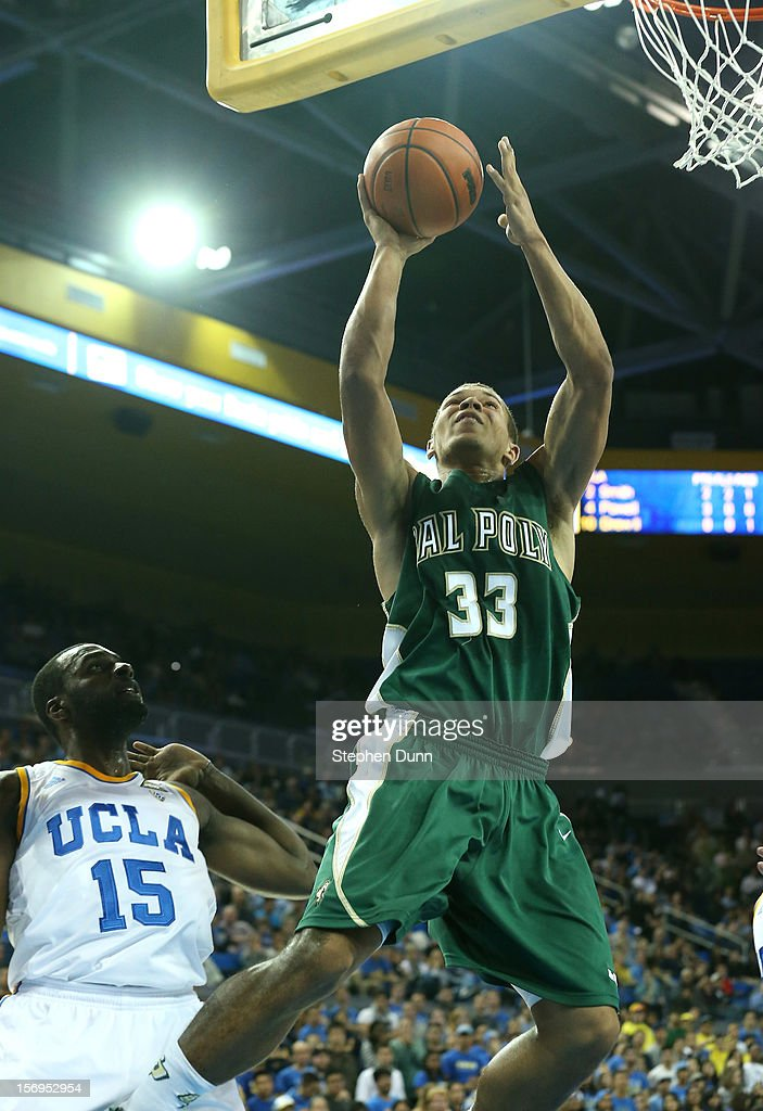 Chris Eversley #33 of the Cal Poly Mustangs shoots over Shabazz Muhammad #15 of the UCLA Bruins at Pauley Pavilion on November 25, 2012 in Los Angeles, California.
