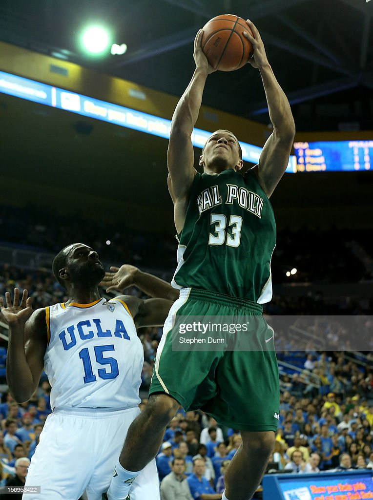 Chris Eversley #33 of the Cal Poly Mustangs shoots over Shabazz Muhammad #33 of the UCLA Bruins at Pauley Pavilion on November 25, 2012 in Los Angeles, California. Cal Poly won 70-68.