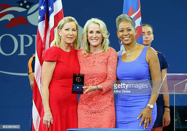 Chris Evert and USTA President Katrina Adams stand alongside newly inducted Tracy Austin during the Court of Champions Ceremony on Day Eleven of the...