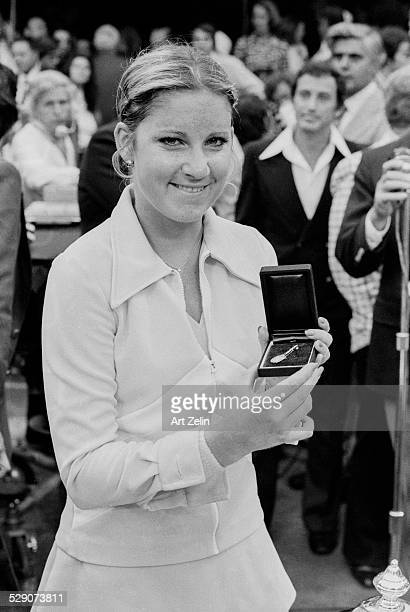 Chris Evert holding a tennis racquet pin after a tennis match circa 1970 New York