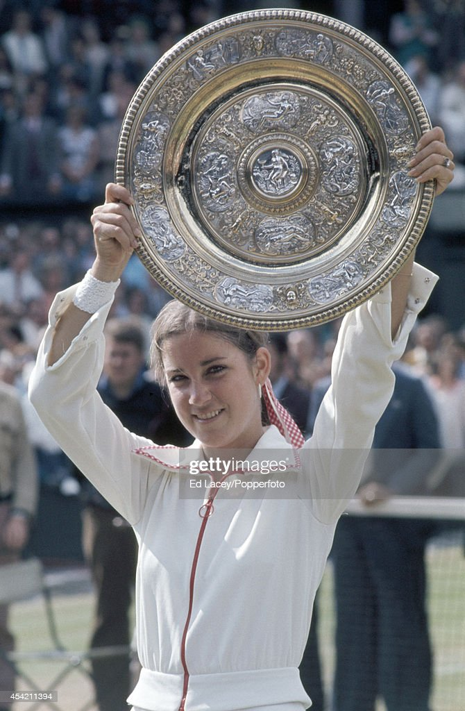 Chris Evert of the United States with the winner's trophy after defeating Olga Morozova in straight sets in the Women's Singles Final at Wimbledon on 5th July 1974.