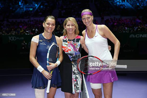 Chris Evert poses with Agnieszka Radwanska of Poland and Petra Kvitova of Czech Republic after the coin toss at the final match during the BNP...