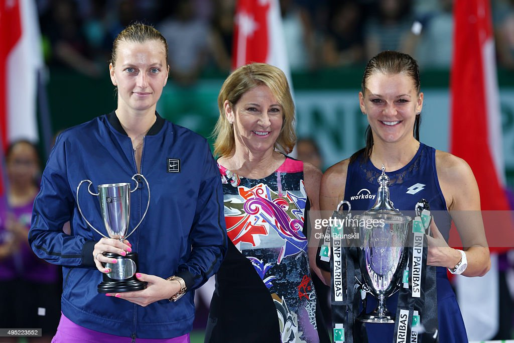 Chris Evert (C) poses with Petra Kvitova of Czech Republic and Agnieszka Radwanska of Poland at the trophy ceremony after their finals match during the BNP Paribas WTA Finals at Singapore Sports Hub on November 1, 2015 in Singapore.