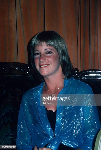 Chris Evert wearing a blue lame blouse at a formal event circa 1970 New York