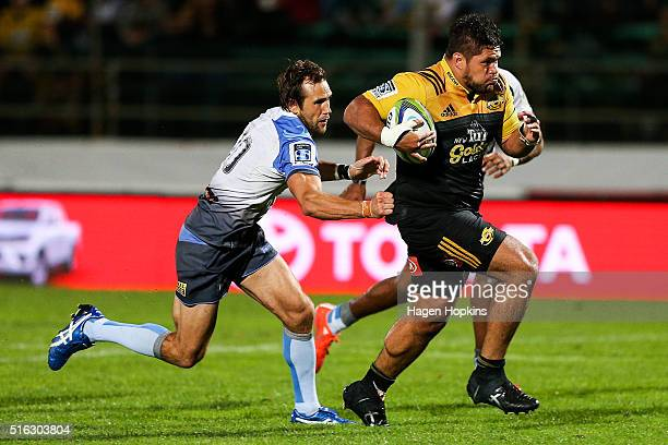 Chris Eves of the Hurricanes makes a break from Peter Grant of the Force during the round four Super Rugby match between the Hurricanes and the Force...